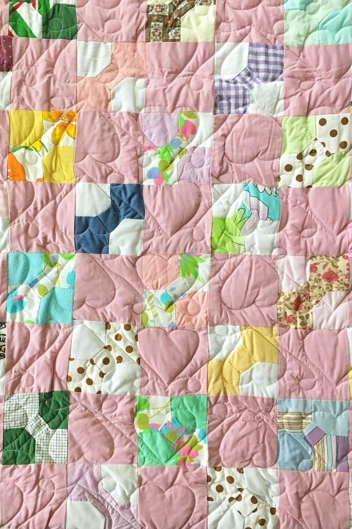 A quilt hand-pieced by Grandma from clothing scraps, circa 1980's