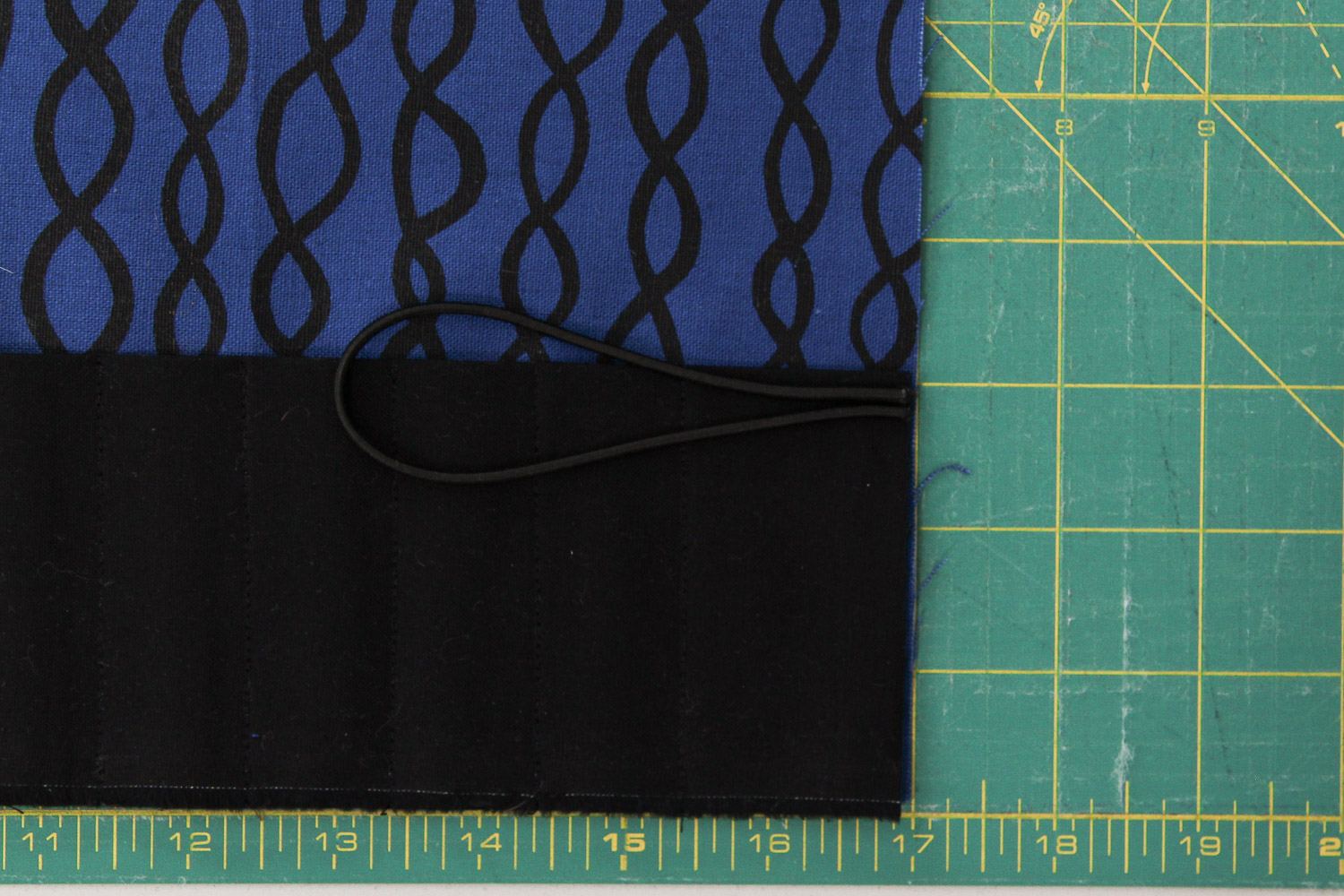 """Align the raw edge of your elastic (or binding, if you choose) and secure with a 1/4"""" seam allowance."""