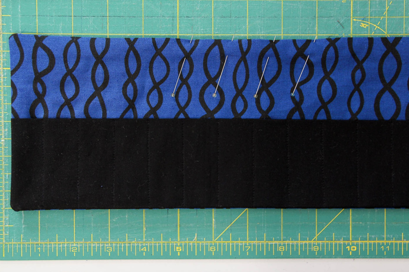 """Pin along the 4-5"""" gap to keep pieces together when topstitching the entire crayon roll."""