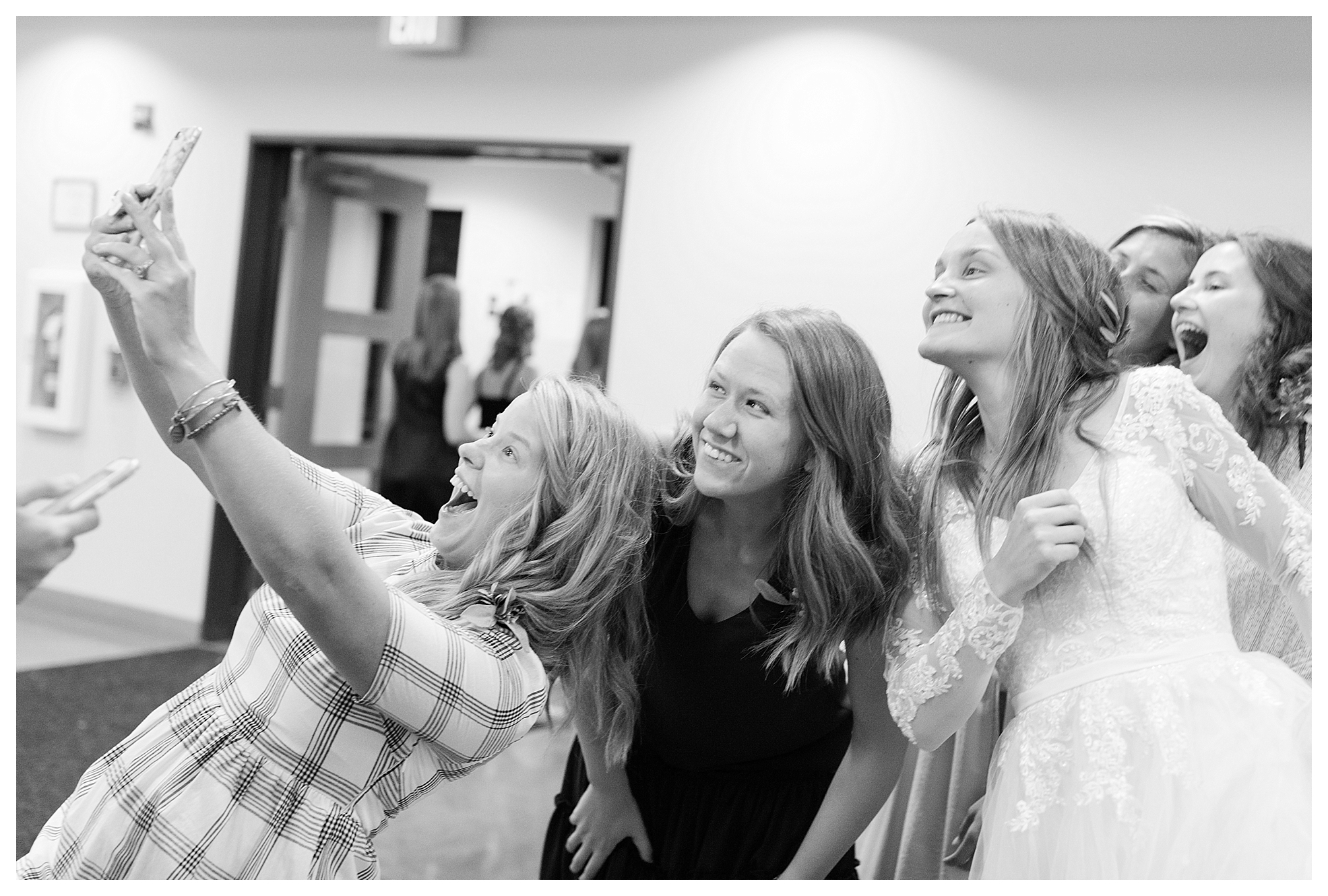 Love!  Your always sure to catch a fun selfie photo at weddings! :)
