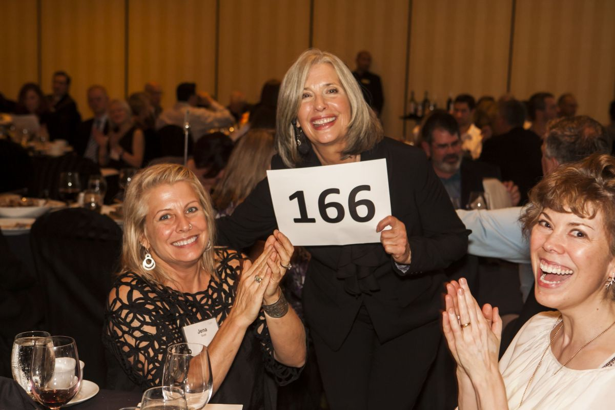 April Brown Auctioneer with Bidder 166