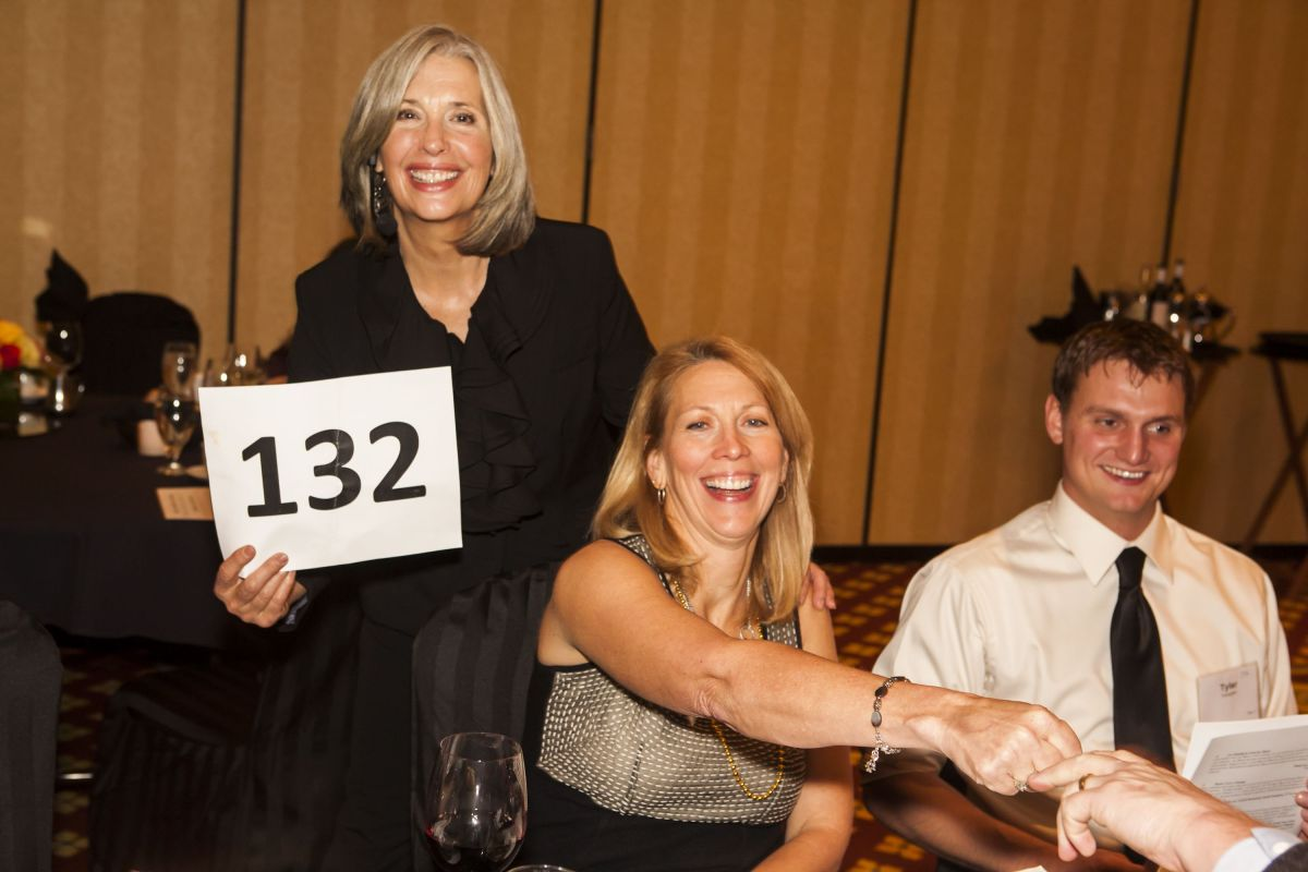 April Brown Auctioneer with Bidder # 132