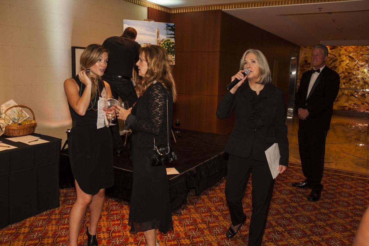 April Brown Auctioneer working Silent Auction