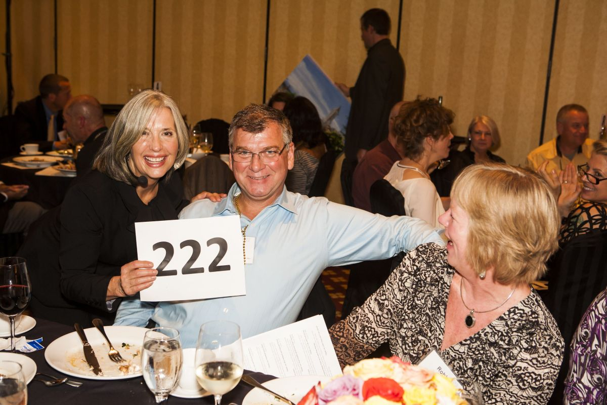 April Brown Auctioneer with Bidder #222