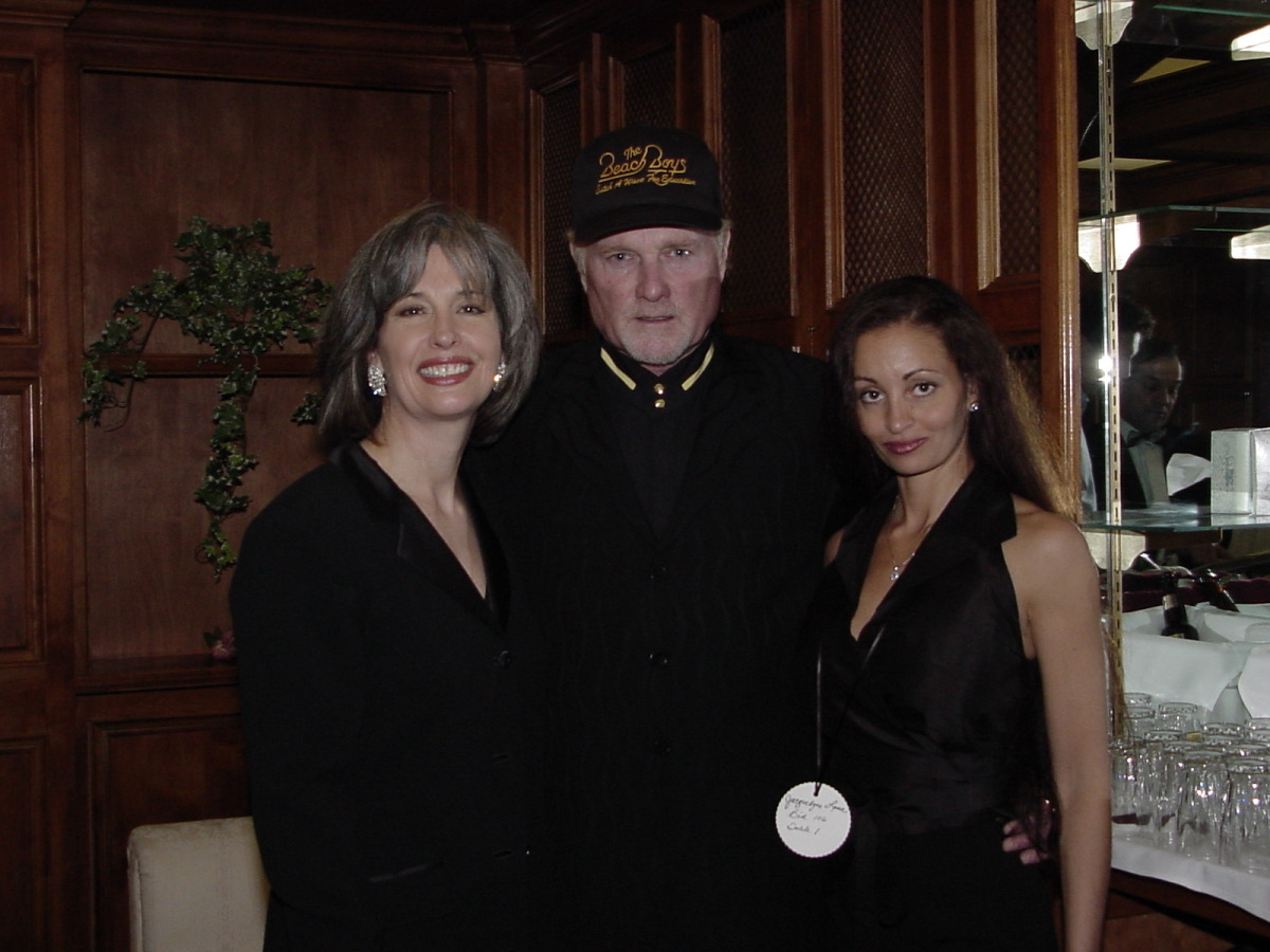 Beach Boy Mike Love, Wife Jackie Love, and April Brown Auctioneer