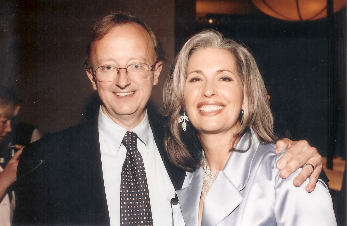 ESPN Sports Anchor John Clayton with April Brown Auctioneer