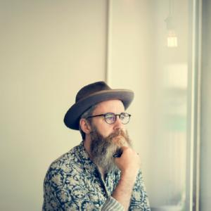 Poet stroking beard