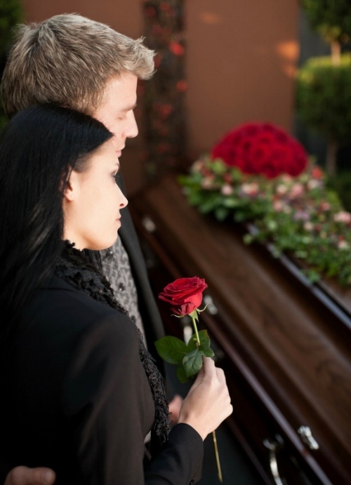 Couple at coffin