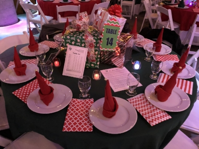 Notice the napkins folded as a Santa hat. This auction planner found this idea on Pinterest as a sailboat napkin and modified it for her holiday charity auction.