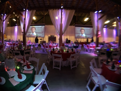 This holiday charity auction was enhanced by a Christmas video muted, playing during the silent auction timeline.