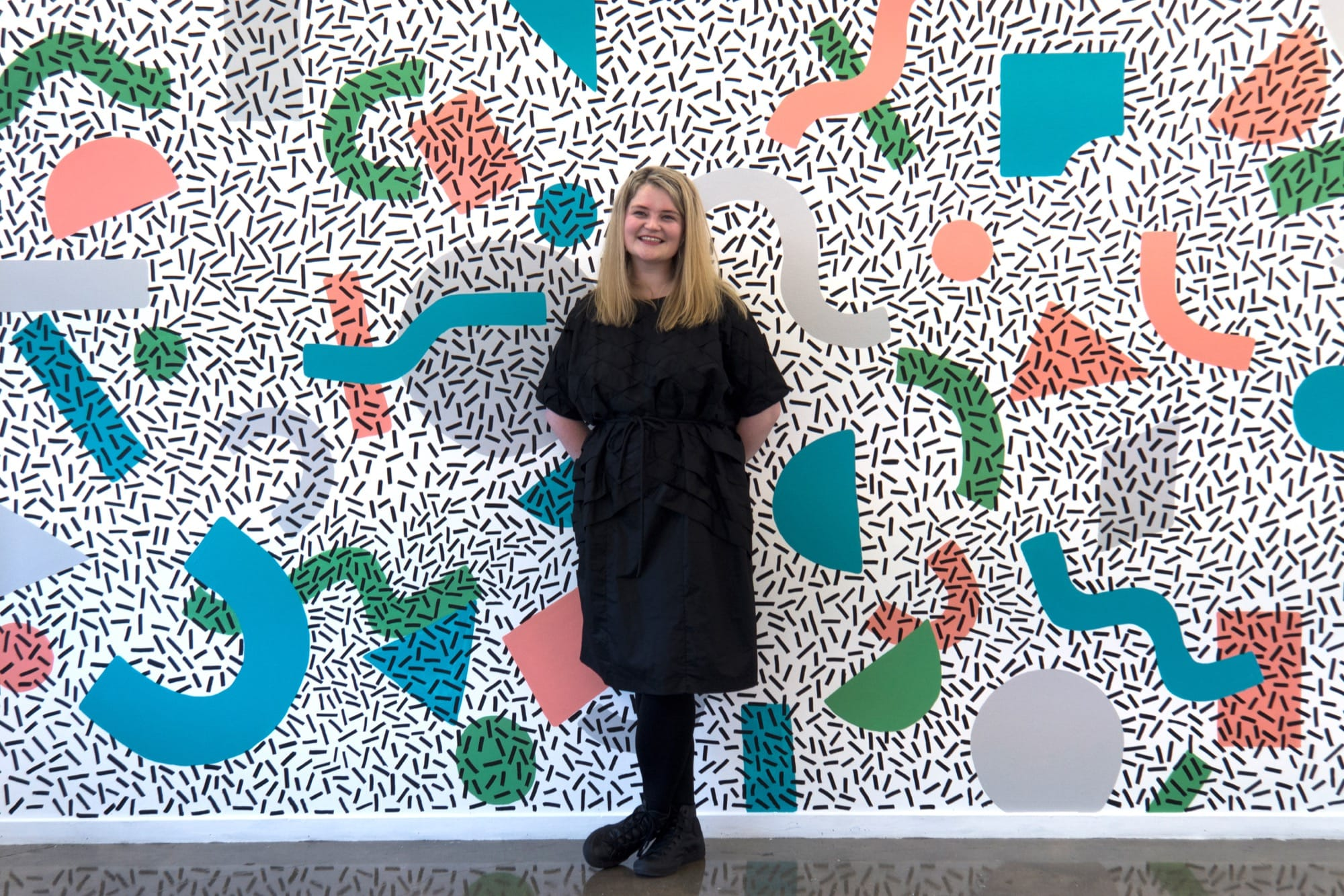 Alice Alva and one of her wall works