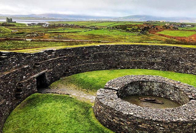 I had this view, and this early medieval stone fort all to myself for 30-45 minutes Tuesday morning. 📍Cahergal Stone Fort (Ballycarberry Castle to the left) | Cahirciveen, County Kerry, Ireland    Built around 600 AD, Cahergal Stone Fort was impressive. Check out Leacanabuaile Stone fort is just up the hill and impressive too. These quote moments with perfect views were more restorative than I can ever properly put into words. . . . #ringofkerry #ireland #wildatlanticway #irelandtravel #ireland🍀 #ireland_gram #irelandaily #dcblogger #dctravelblogger #walkwithlocals #flydelta #beautifuldestinations #medieval #wearetravelgirls #agameof5k #visitireland #cahirciveen #cahergallstonefort #countykerry #roadtrip #kerry #letsgosomewhere #katefromoz #kandywedding