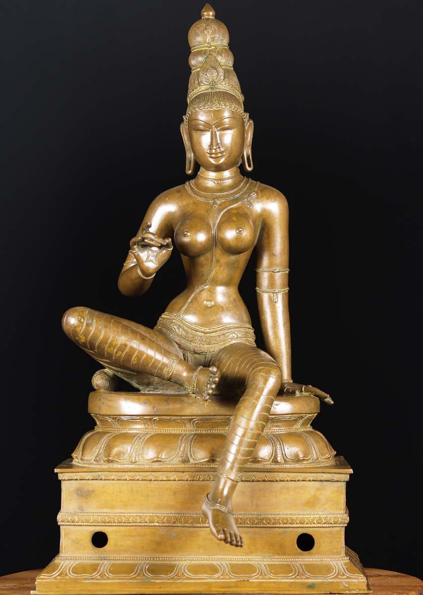 Shakti embodies Devi's sexual energy, Boga or pleasure. Bogashakti is the form that Parvati takes before going into the inner sanctum of a temple with her husband, Shiva. Her faced is framed by a halo or chakra as she sits upon a raised throne in the lalitasana seated position with one leg raised under a pillow and the other hanging down.