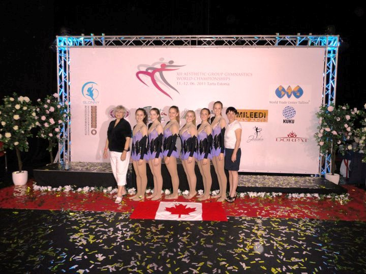 Michelle Hankin ,  Zoë Goldstein ,  Emily Cossar ,  Emily Ruppert , Evelyn Koop, Coach Alla, and  Alena V. . World Championships in Estonia 2011. Canadiana B Team
