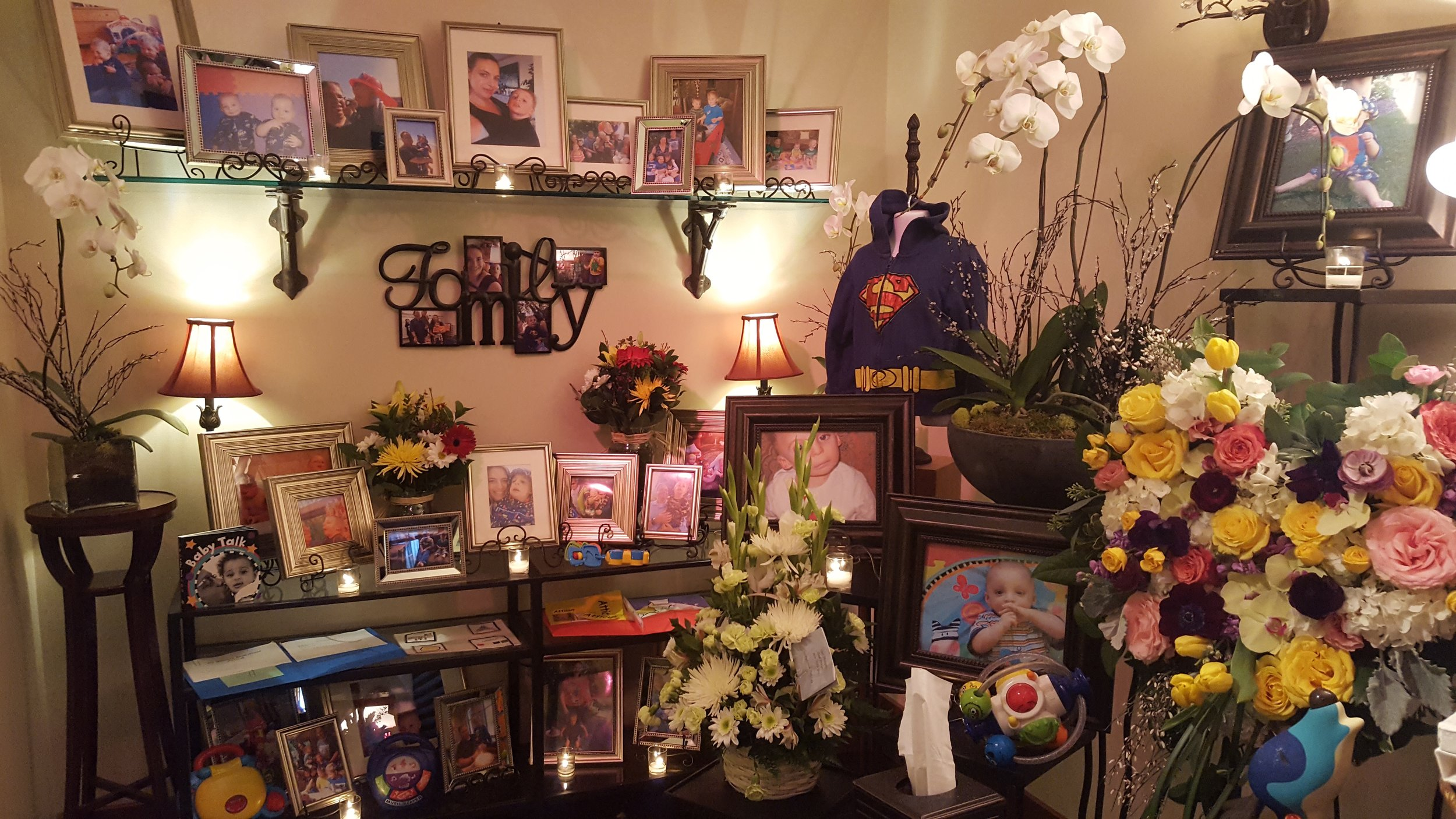 Atticus's celebration of life. This entire room was filled with pictures of Atticus and some of his favorite toys and activities.