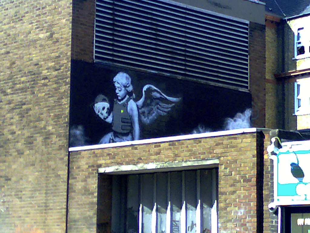 Ozone's Angel . Banksy @ Old St., photo by Darren from London, England - CC BY-SA 2.0
