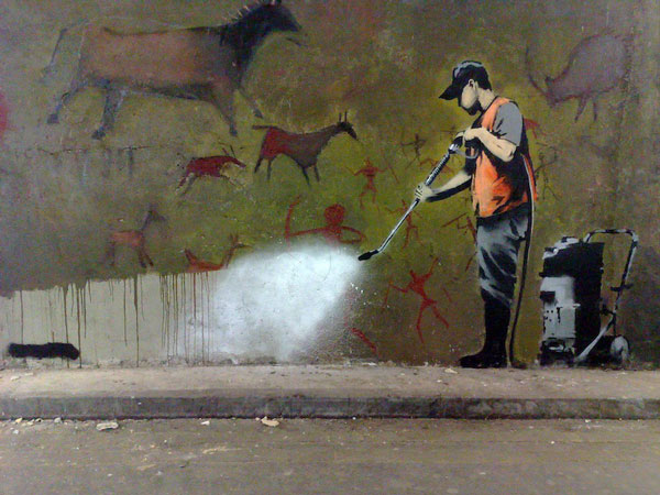Another one by Banksy, the metaphor about cleaning up cave paintings comes through like a splash of cold water. I love this one.  Image source