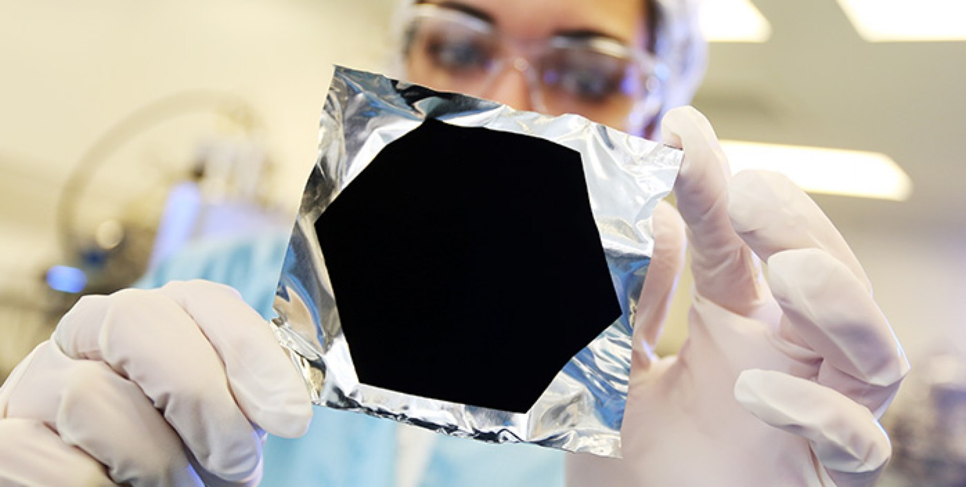 A PHOTO OF VANTABLACK ON CRUMPLED ALUMINUM FOIL FROM  SURREY NANOSYSTEMS . I'M PROBABLY IN TROUBLE JUST FOR SHOWING IT TO YOU ON AN ART BLOG.