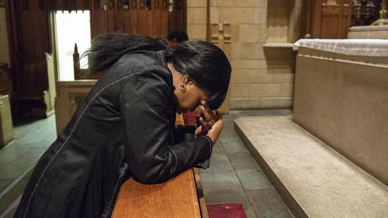 (Oneita Thompson prays in the sanctuary of the First United Methodist Church of Germantown. She and her husband, Clive, are from Jamaica and were living in South Jersey since 2004 before receiving deportation orders and seeking sanctuary at the church.  Heather Khalifa/ Philadelphia Inquirer)