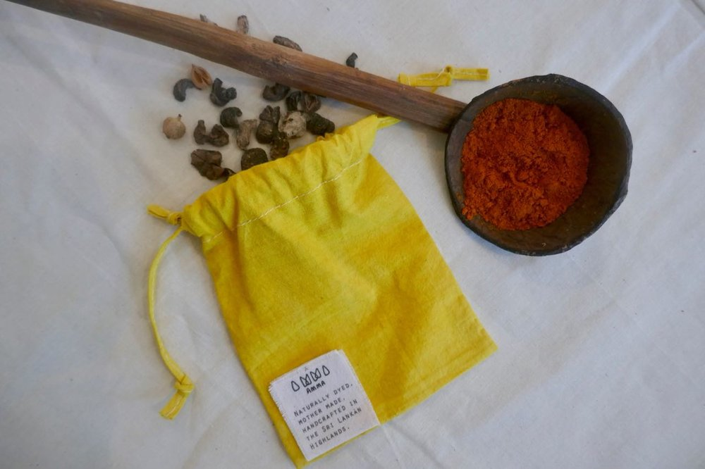Turmeric dyed pouches, made by AMMA for Wunder Workshop