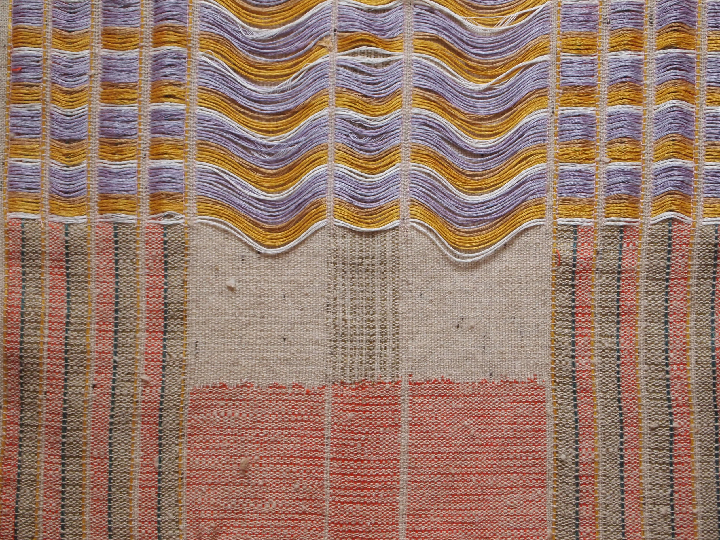 Woven piece using naturally dyed yarn.