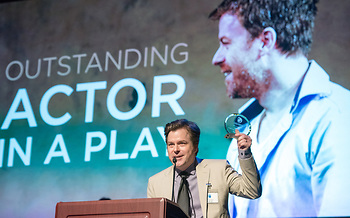 """Eric Bryant receiving the CCC Award foie """"The Invisible Hand."""" Photo by Mara Lavitt."""