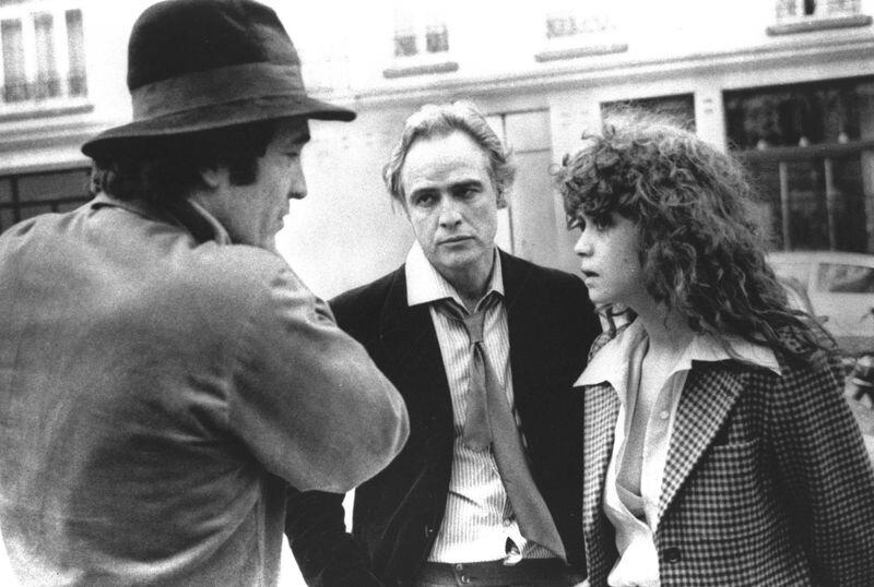 "Director Bertolucci, Brando and Schneider discussing scene from  ""Last Tango in Paris"""