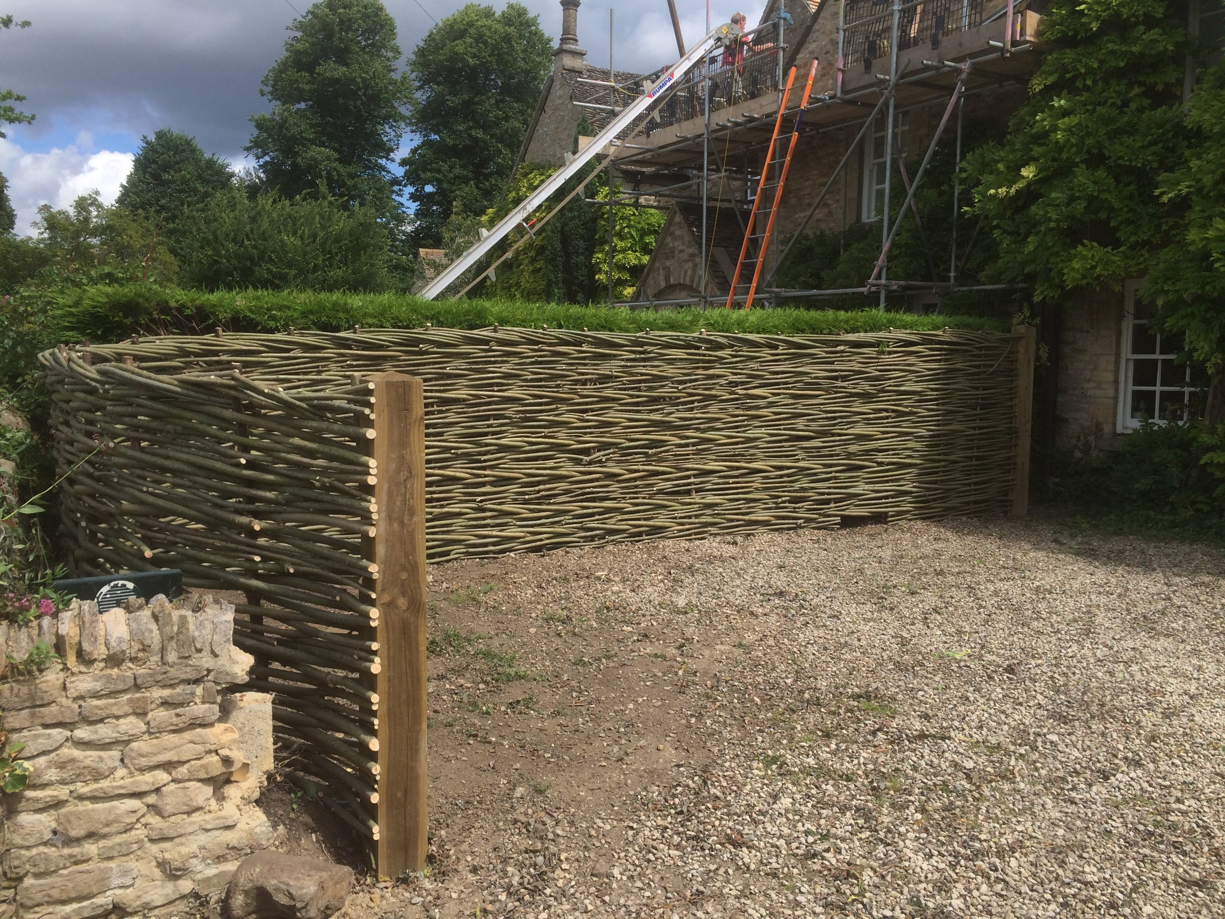 A natural woven willow fence