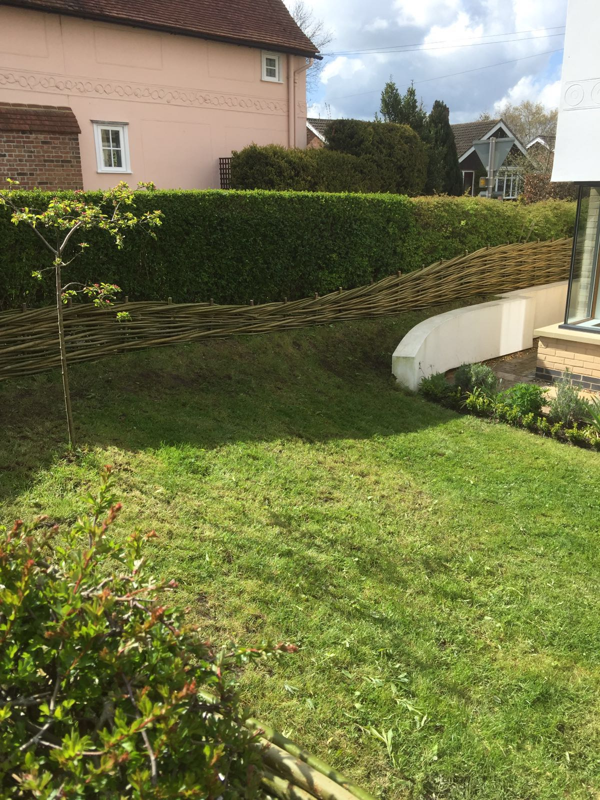 Gradual sloping willow fence