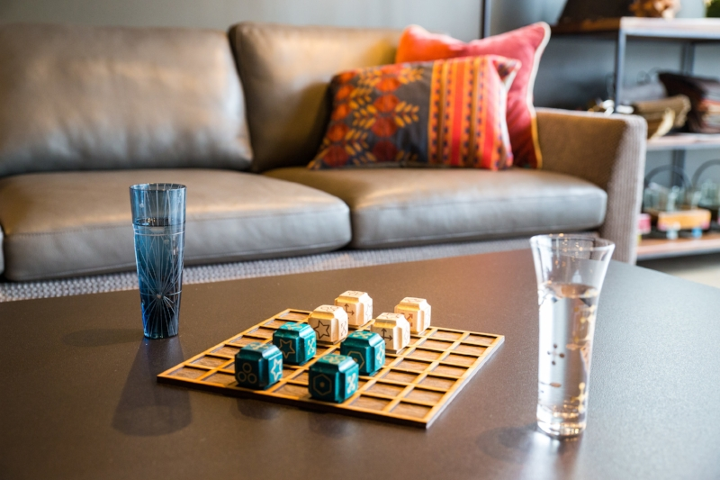 Deblockle: Pictured next to water glasses on the coffee table.