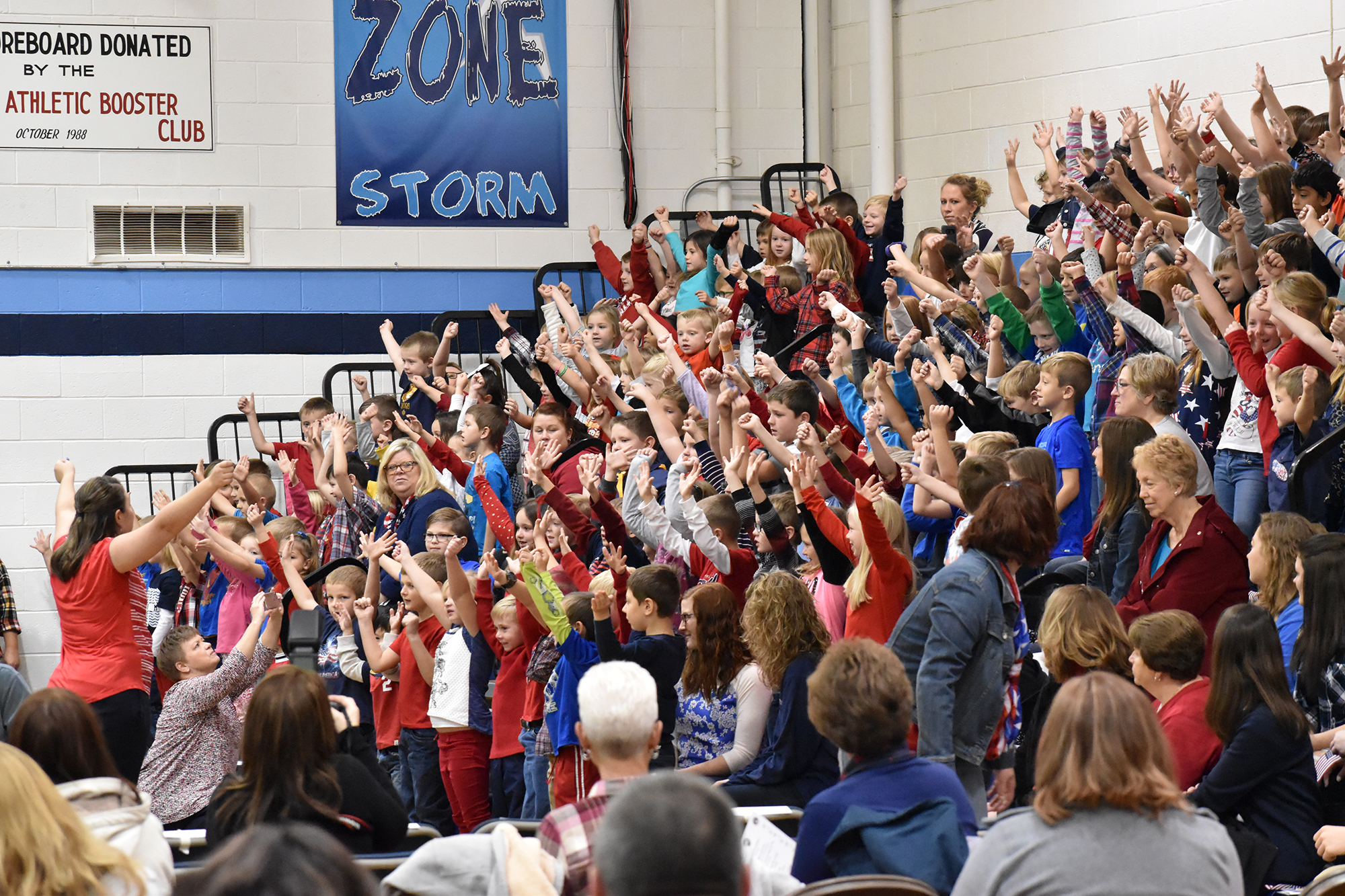 "Elementary Students, led by Amy Degenhart and Janell Magnusson, sing ""Tribute to the Armed Forces"""