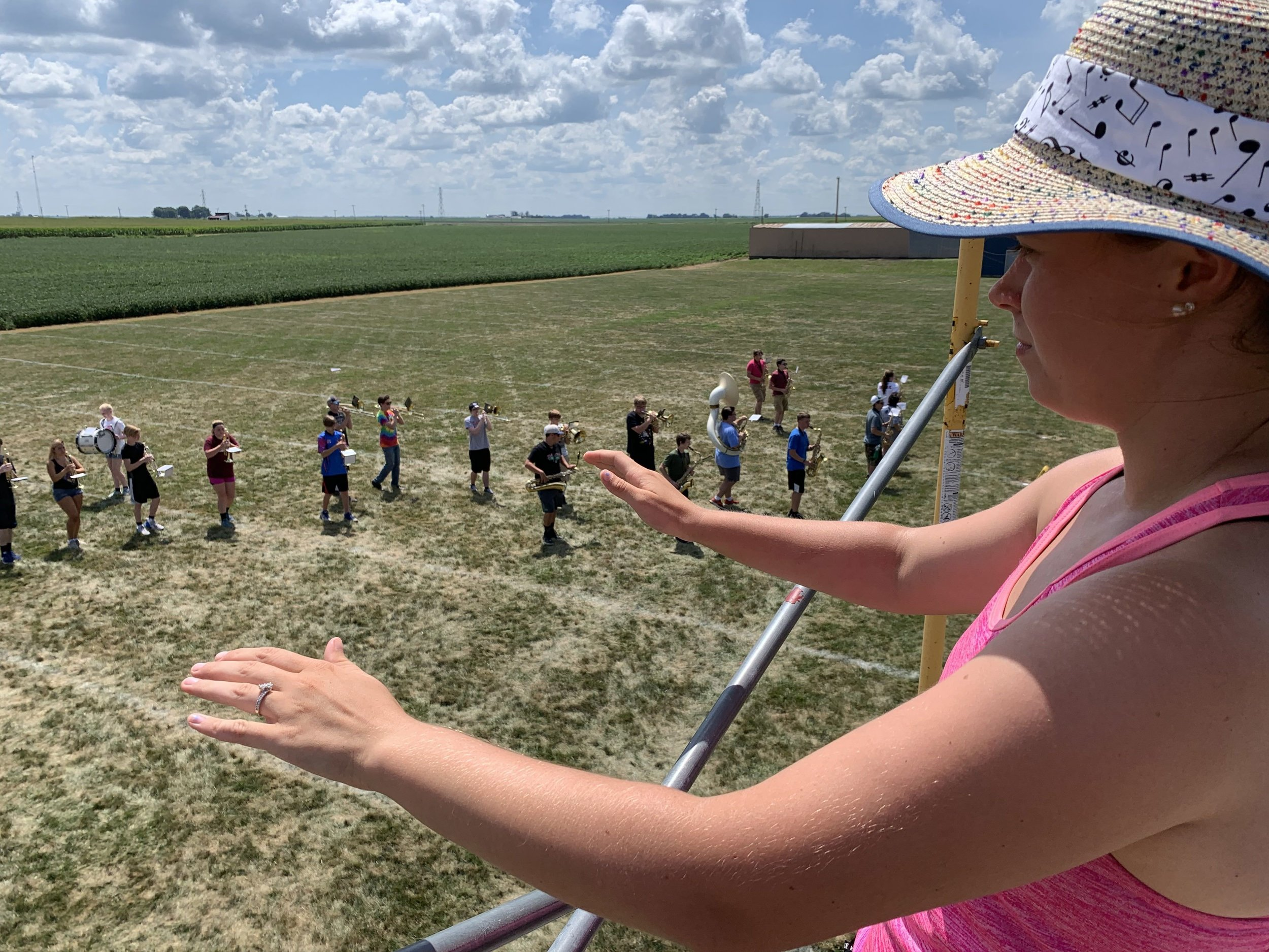 Drum Major Sierra Centola conducts the band.
