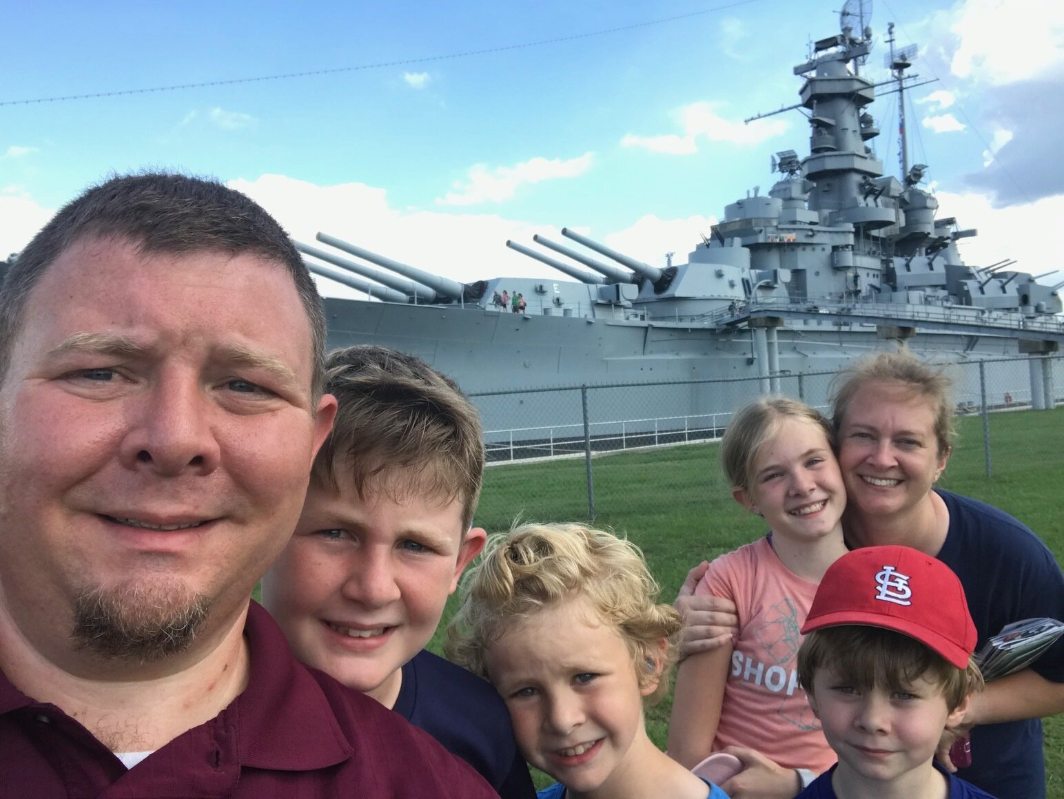 Mr. Martin's family in front of the U. S. S. Alabama, one of their many stops over the summer.