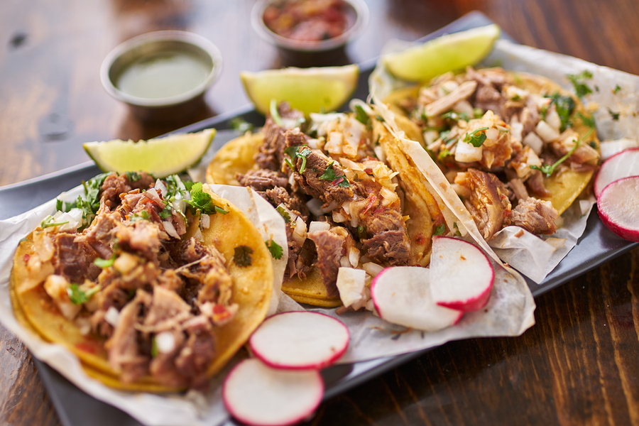 bigstock-three-street-tacos-in-yellow-c-105485111.jpg