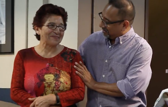Doña Lilia, pictured with HOLA Operations Director Alex Nataren, after hearing news of her award.