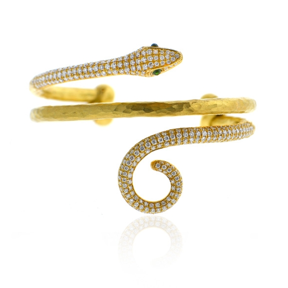 18k yellow gold serpent cuff with diamonds and two emerald cabochons.jpg