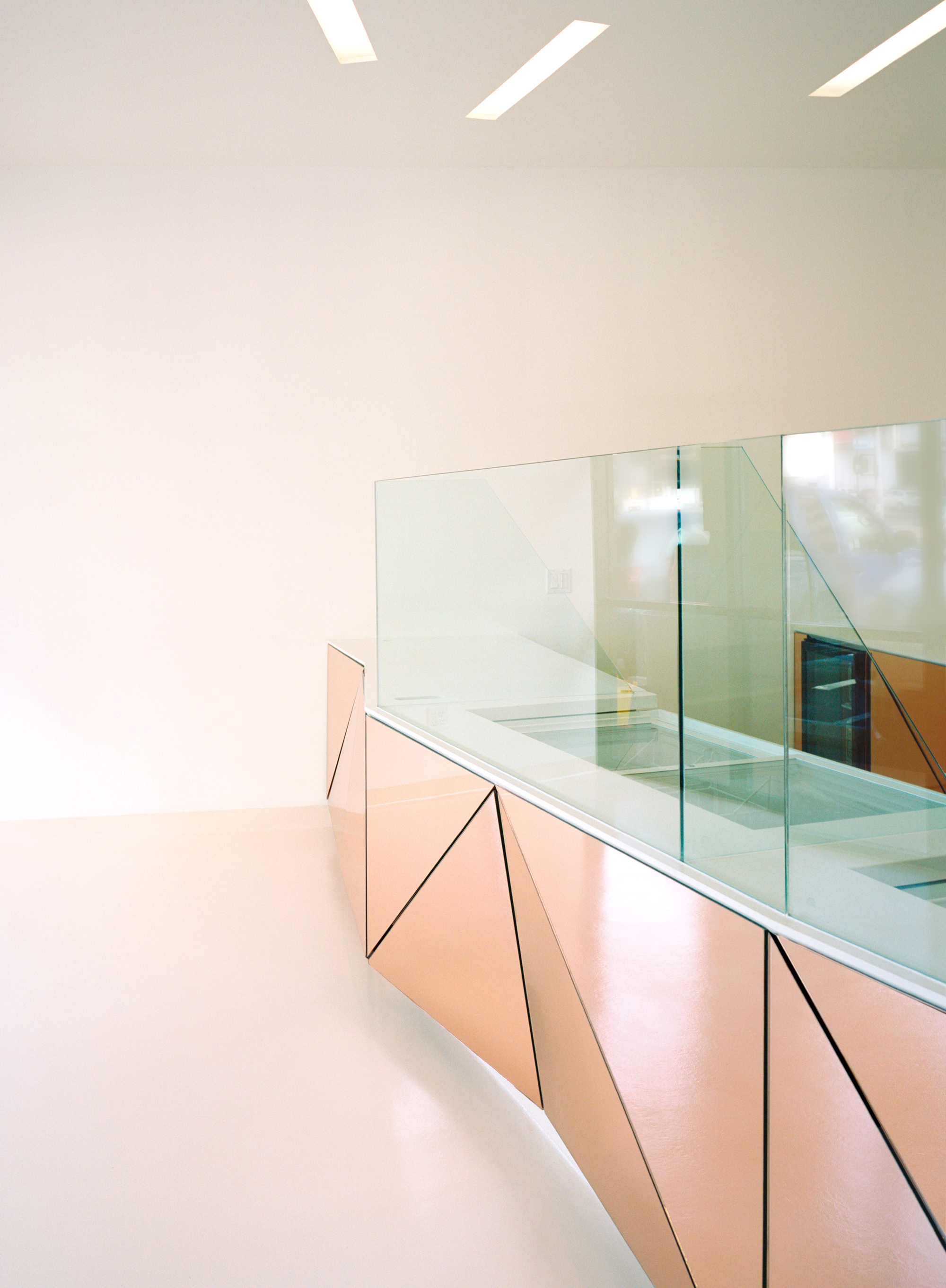 The floors were finished with a durable epoxy resin that give the space a soft, playful feel while be is easy maintain.