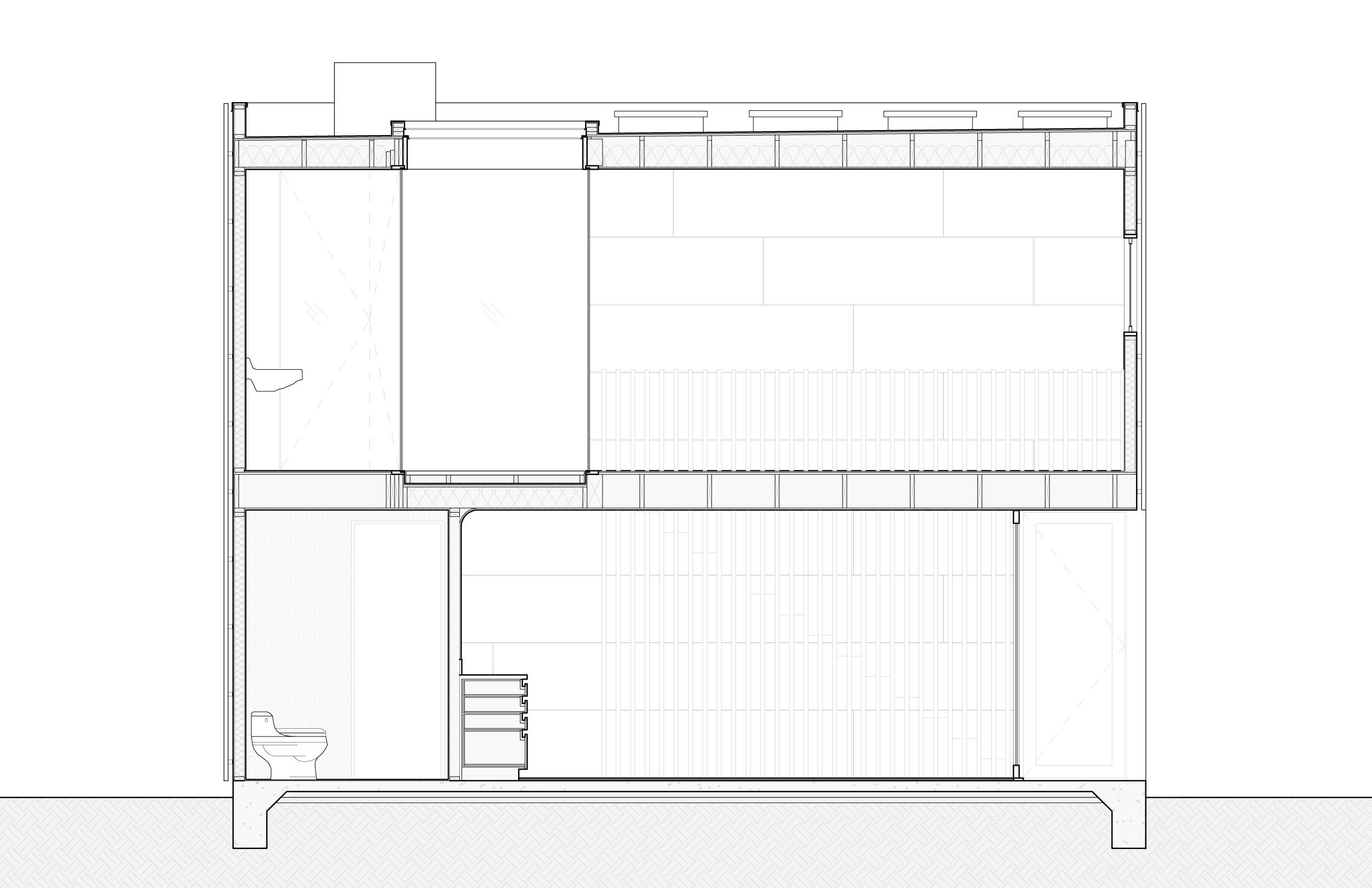 Section through the bathrooms, atrium and studio.