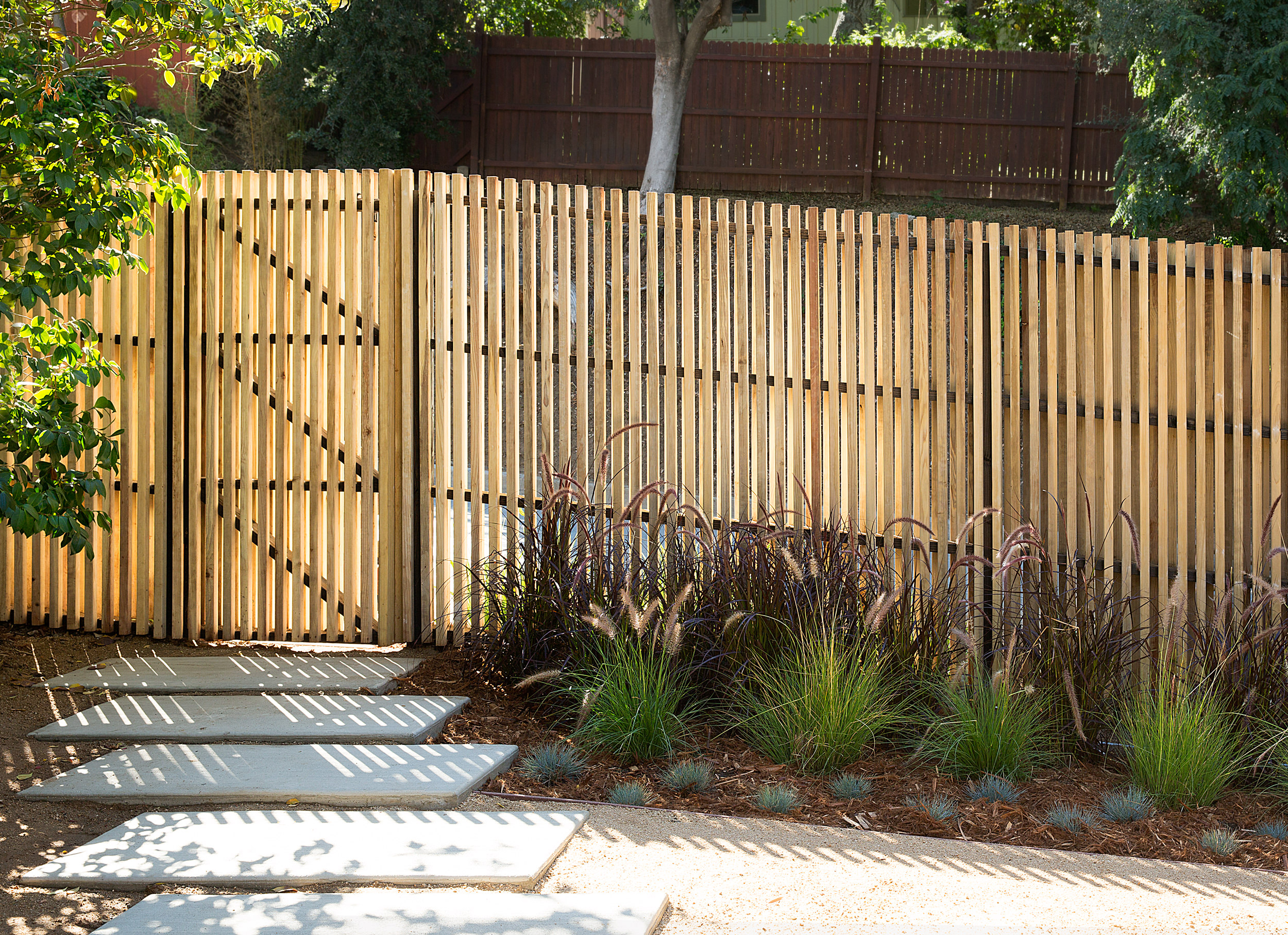The fence provides privacy while letting light into the front yard.