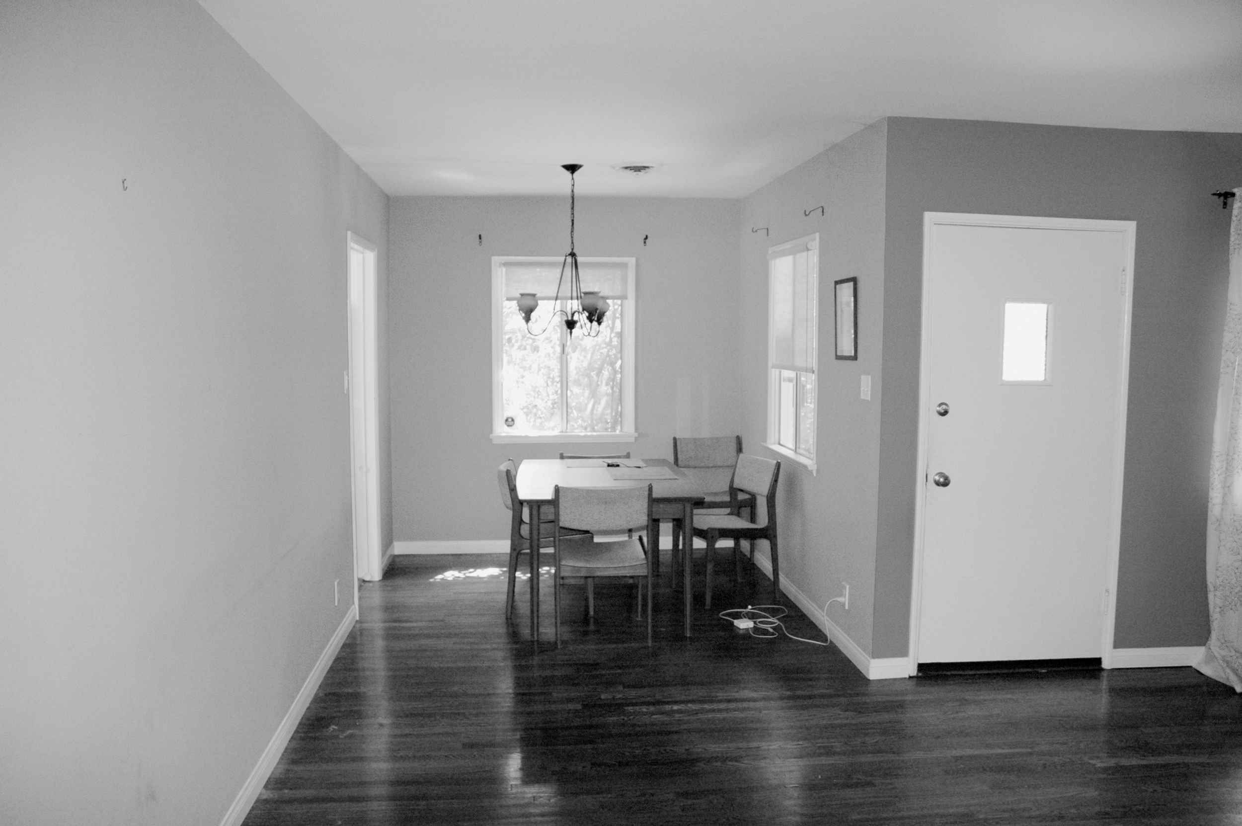 View of the entry and living room prior to the renovation.