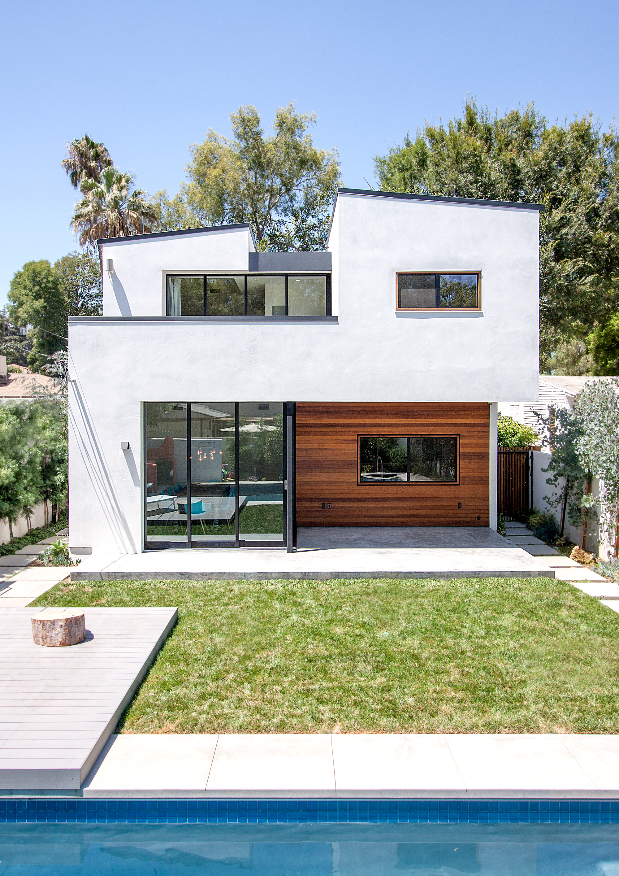 The doors at the rear of the house slide to create a seamless connection between the living spaces and the backyard. On the second floor, the doors open from the master suite to a large balcony that overlooks the pool.