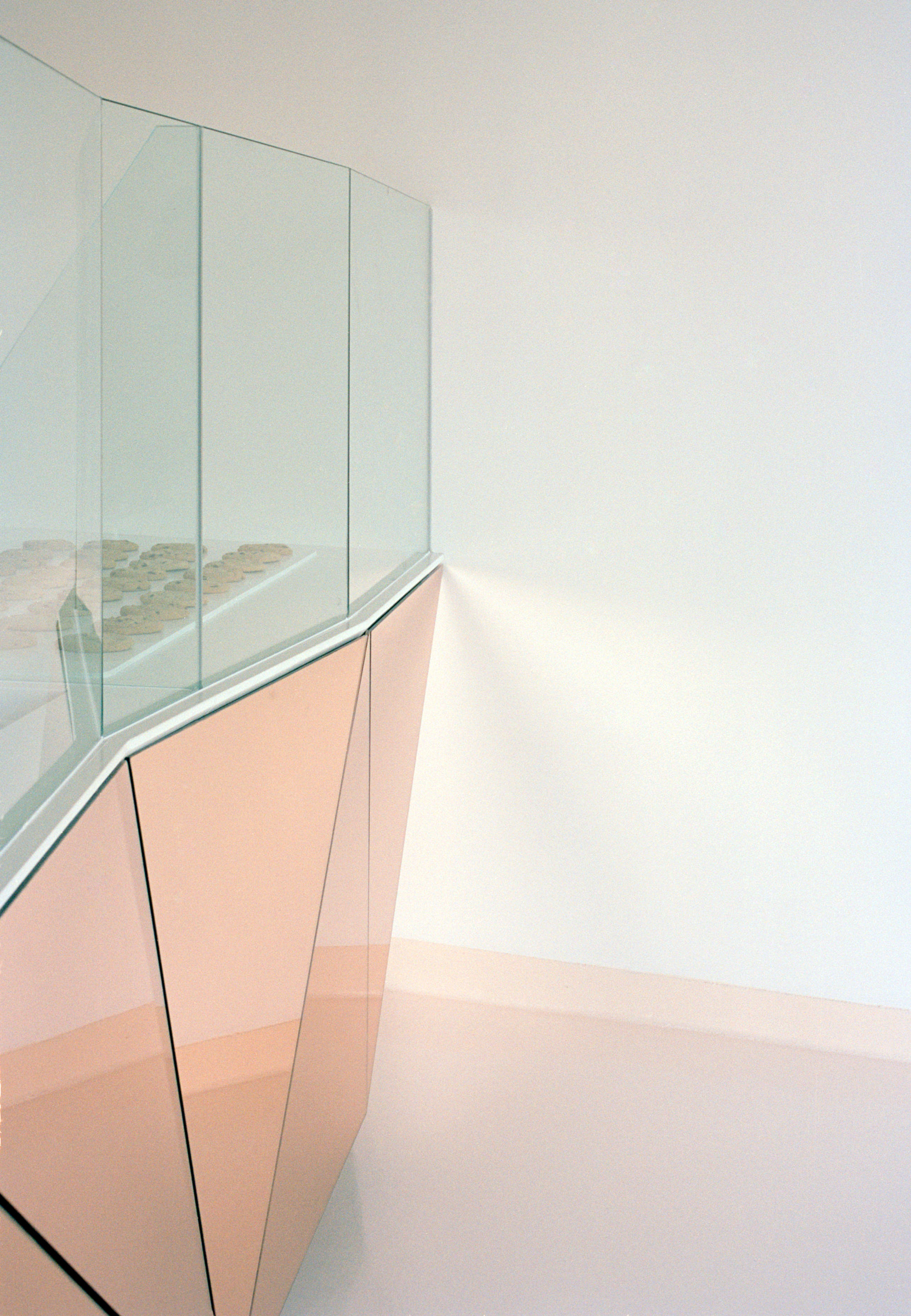 Throughout the day the faceted mirror reflects continually shifting shades of peace.