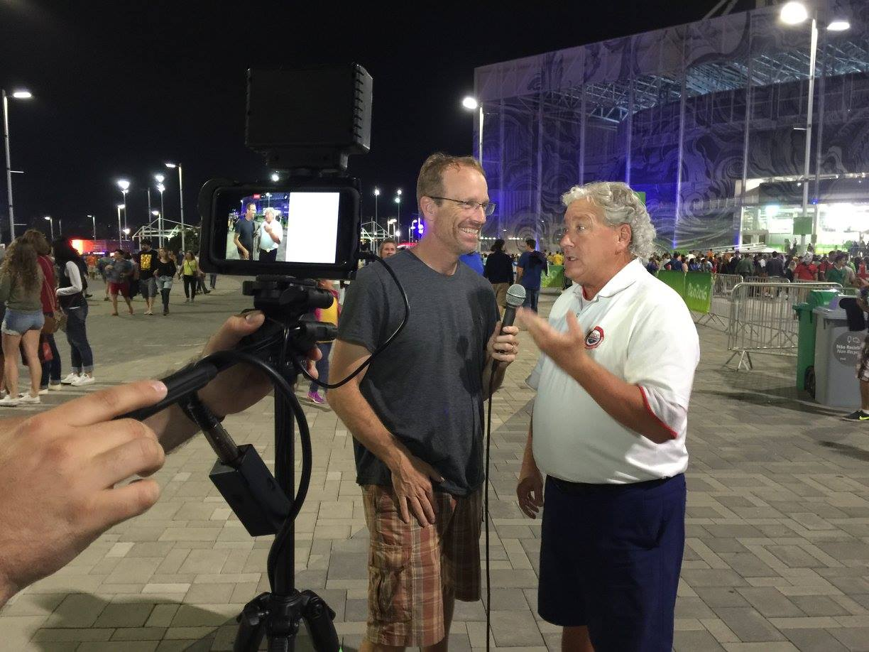 Joe with Coach Sid Cassidy going live right before the swimming finals in Rio.