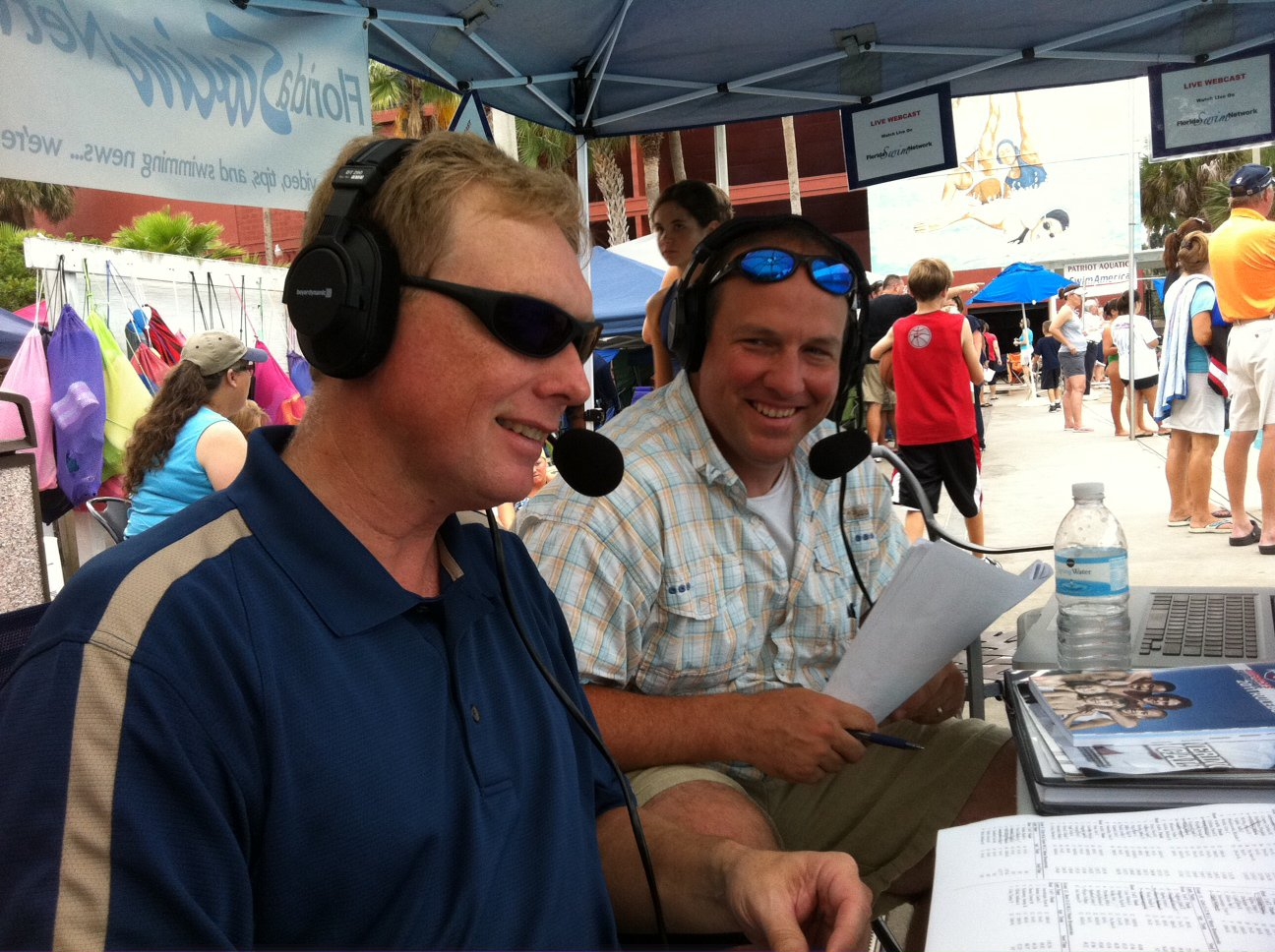 Parents Dave Van Buskirk and Michael Kennedy volunteered their time to commentate a swim meet and man the chat room.