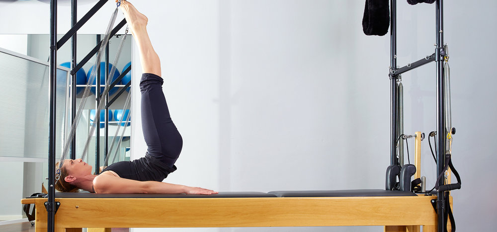 Pilates-+Studio-woman-in-reformer.jpg