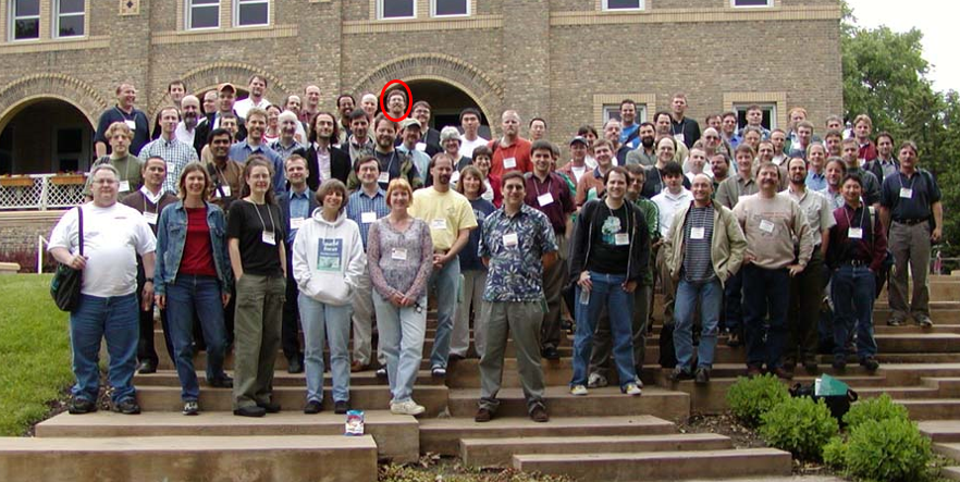 A younger me in the group photo from the very first Mapserver User Meeting in 2003