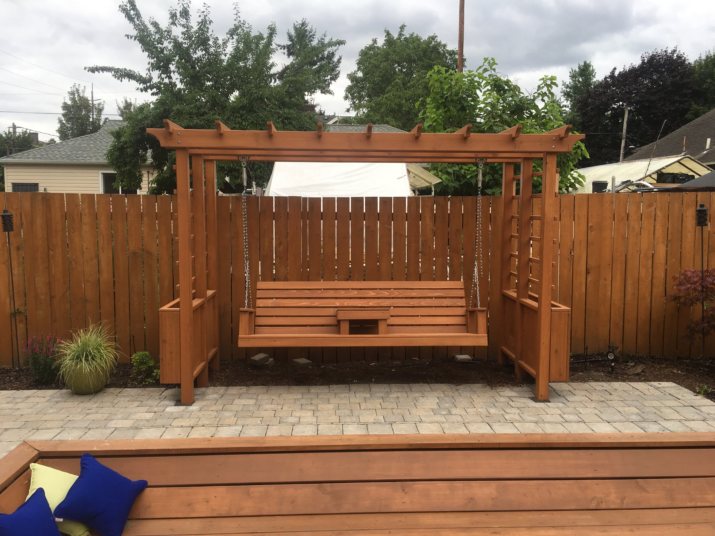 Arbor with bench swing.