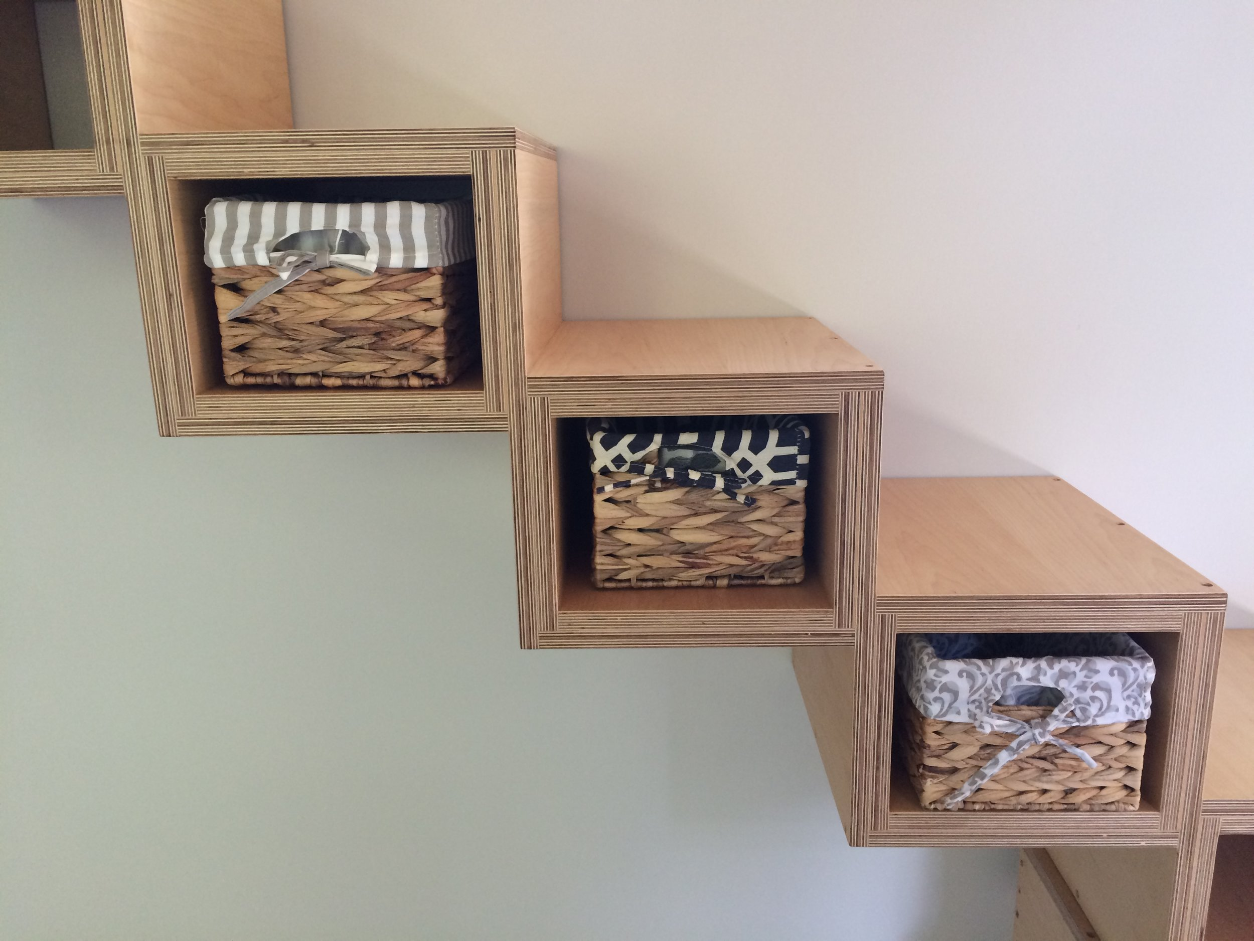 Tiny house stairs - with baskets.