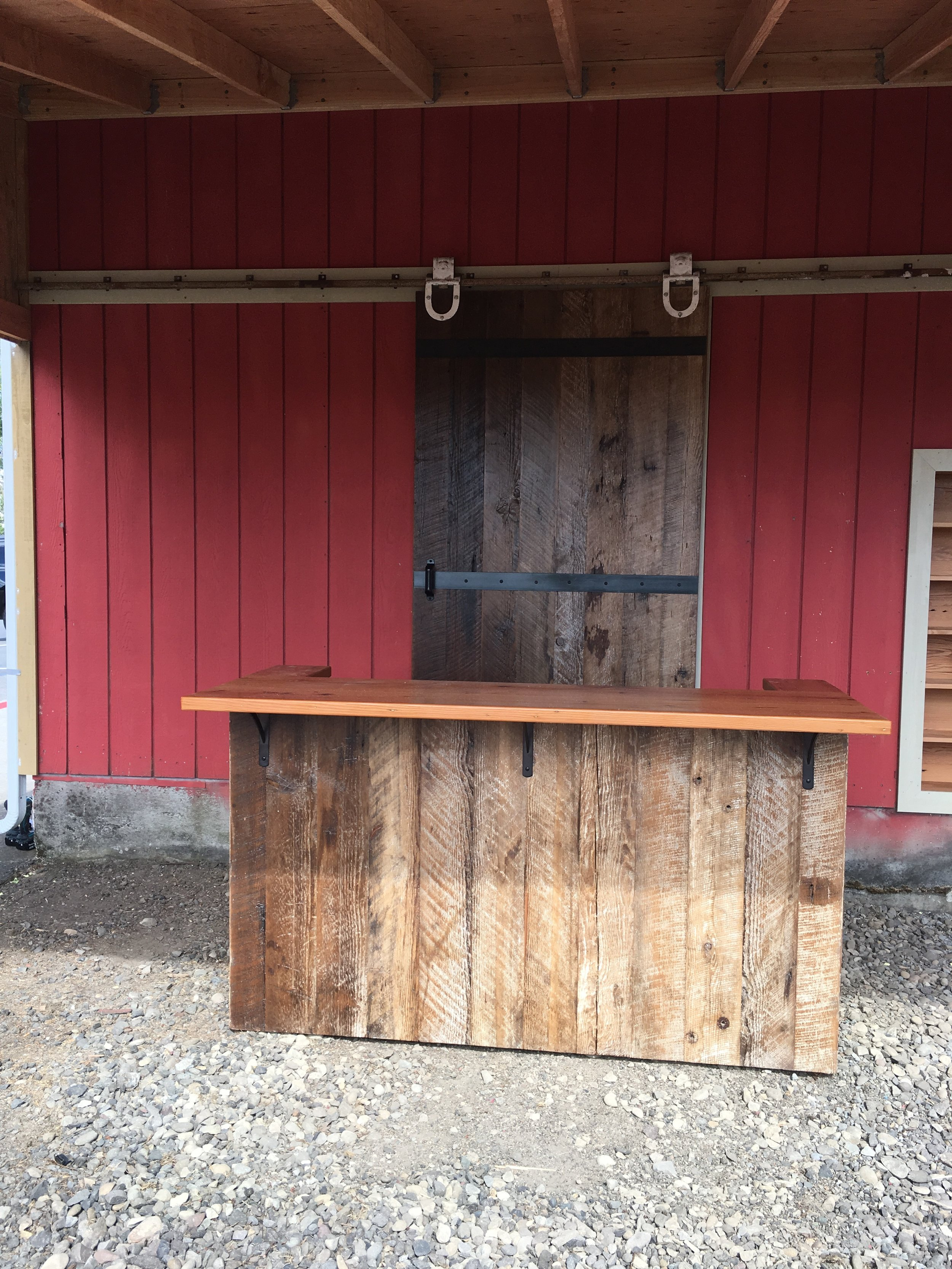 Custom bar and barn door using reclaimed wood from the property