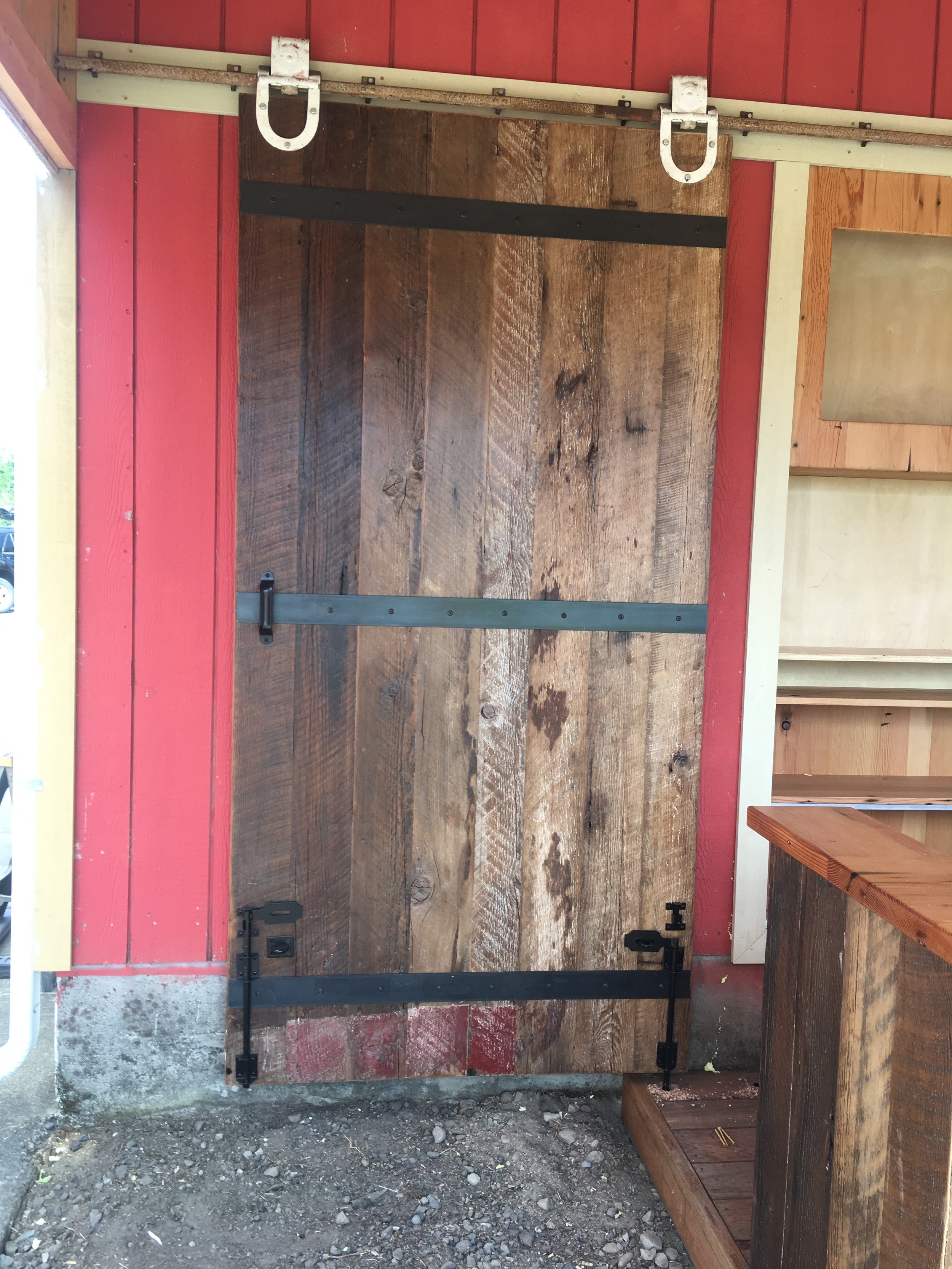 Barn door using reclaimed wood, track and rollers from the property.